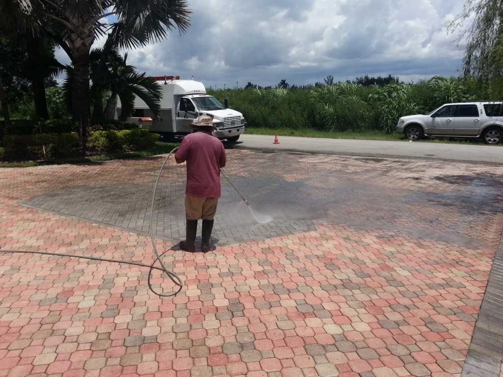 How to clean brick pavers | rinse down the area